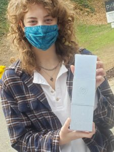 Student holding Dalstrog donation box.