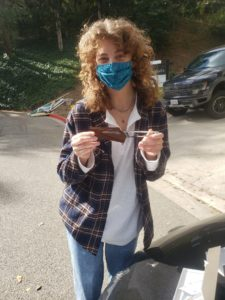 Student holding Dalstrong knife donation.